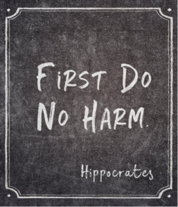 "blackboard with text ""first do no harm"" and signature Hippocrates"